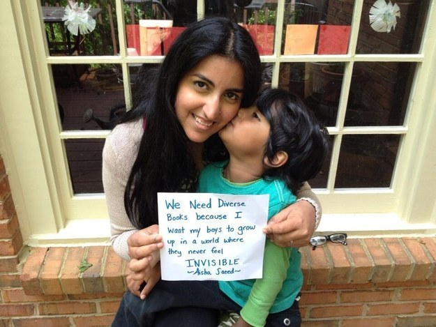 WNDB team member Aisha Saeed holds up a #SupportWNDB cue card with her young son.