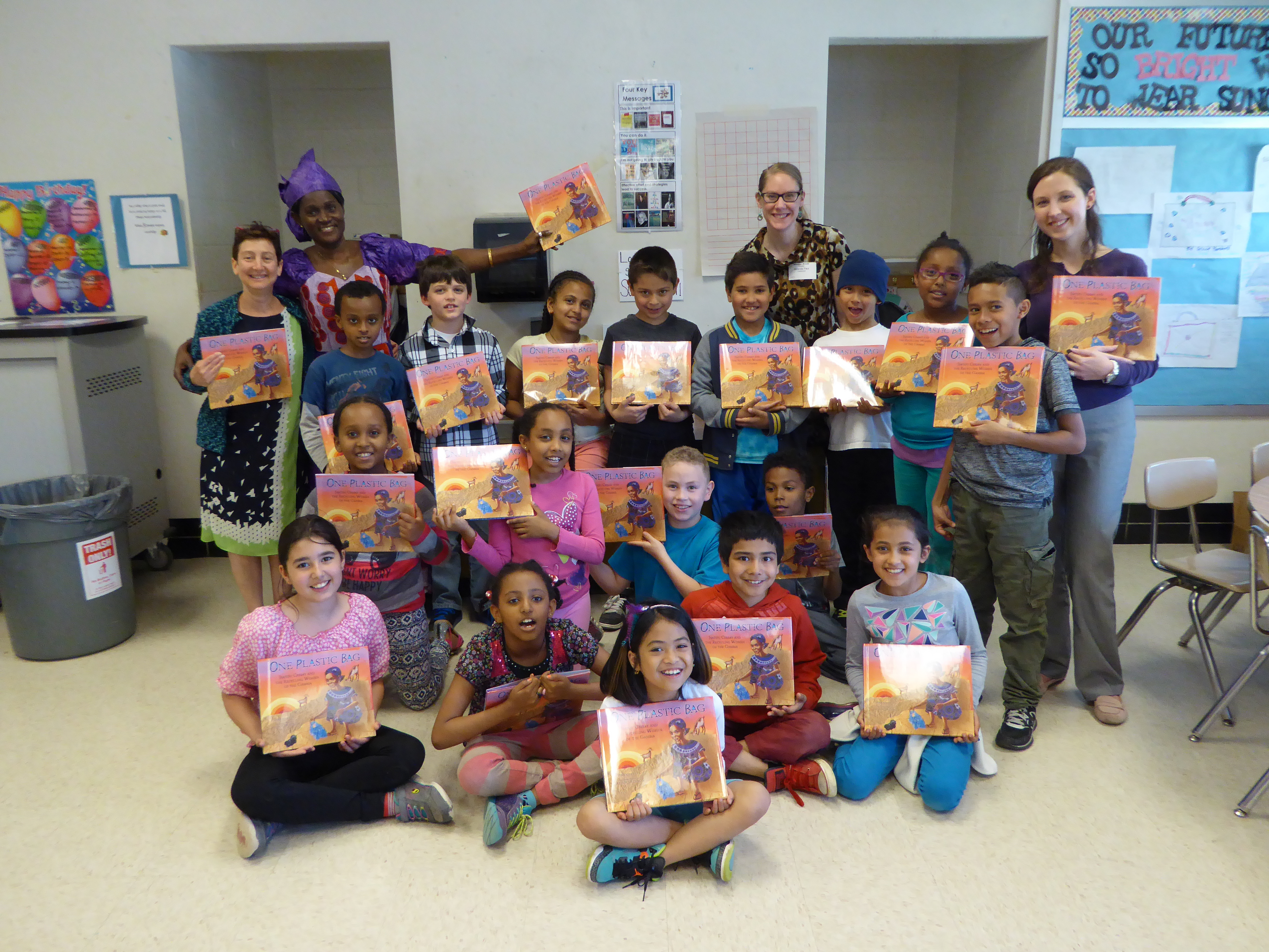 Students pose with their new books after a WNDB in the Classroom visit.