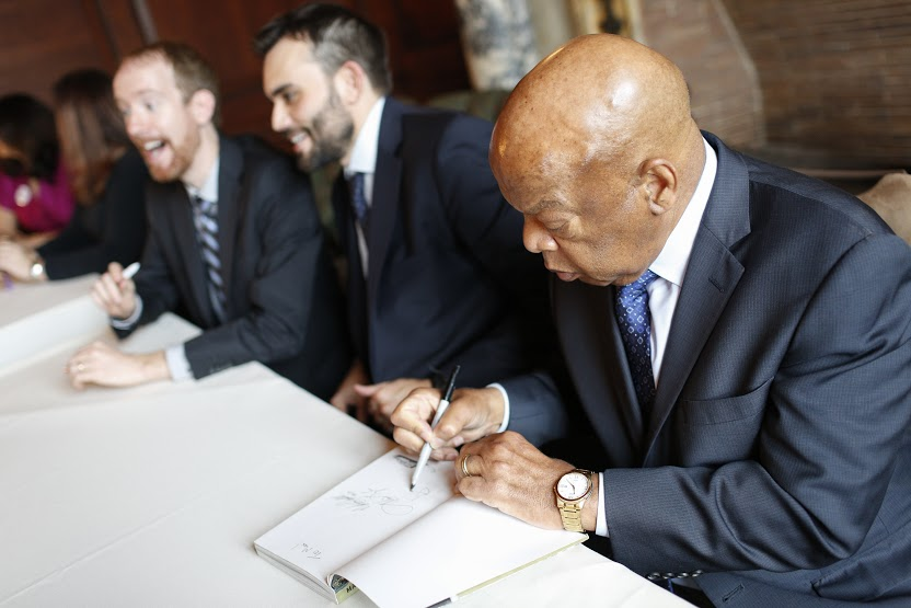 """U.S. Rep. John Lewis signs copies of his Walter Award-winning book, """"March: Book 3"""" at a reception in the Members Room, March 31, 2017. Photo by Shawn Miller."""