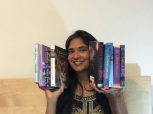 Author Padma Venkatraman holding several books